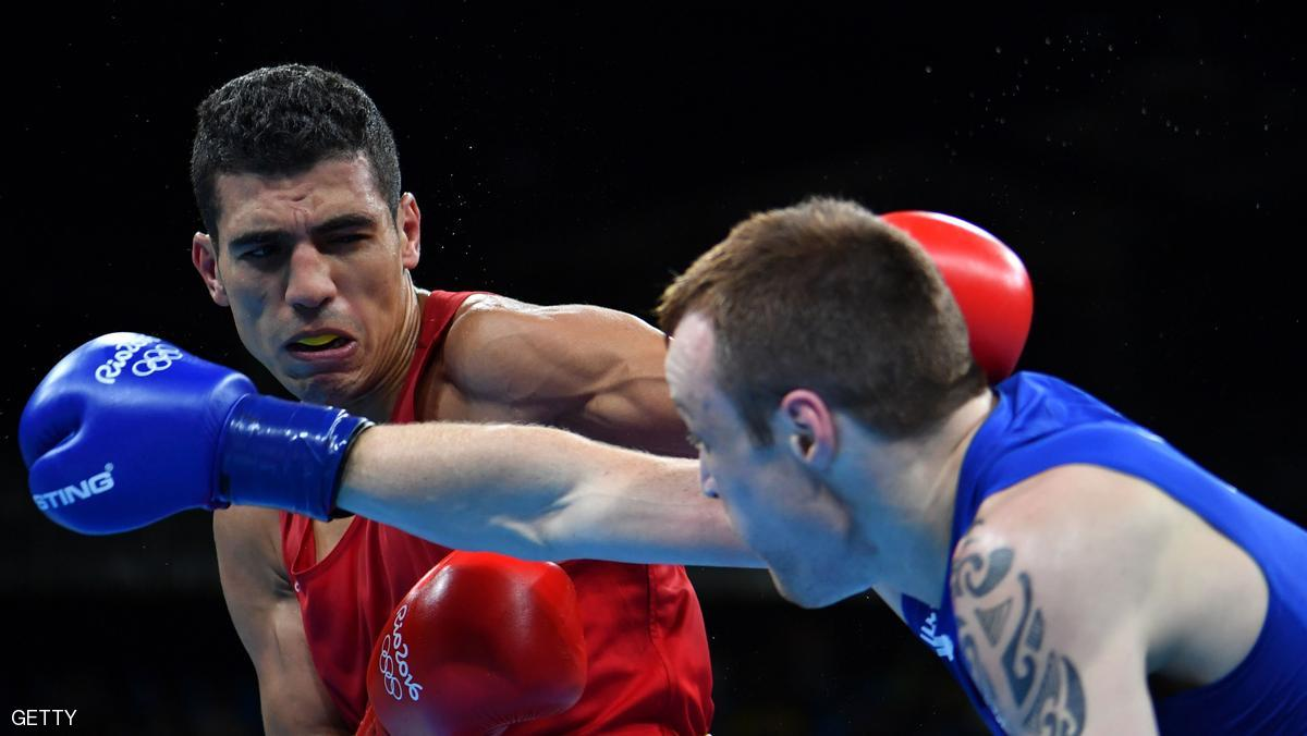 Morocco's Mohammed Rabii (L) blocks a punch by Ireland's Steven Gerard Donnelly during the Men's Welter (69kg) Quarterfinal 1 at the Rio 2016 Olympic Games at the Riocentro - Pavilion 6 in Rio de Janeiro on August 13, 2016. / AFP / Yuri CORTEZ (Photo credit should read YURI CORTEZ/AFP/Getty Images)